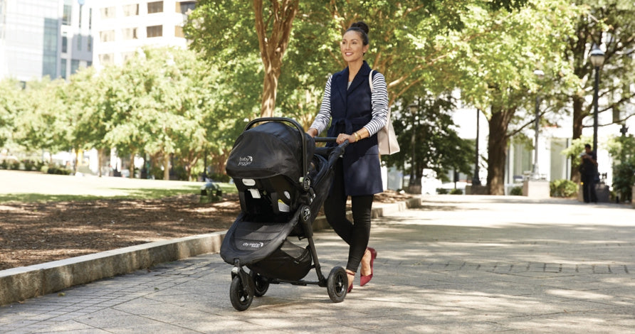 7JA00-baby-jogger-city-mini-travel-system-mom-strolling-infant-in-car-seat-city-astm-in-use-2