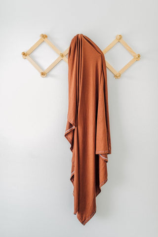 Mebie Baby Stretch Swaddle - Rust