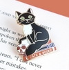 Jubly Umph Lapel Pin • Cats and Books