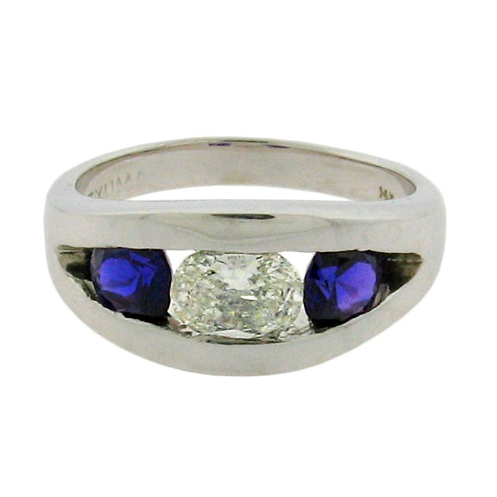Oval diamond with round sapphires set in 14 k white gold