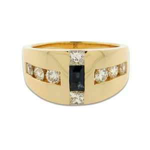 two princess cut green sapphires in center with round diamonds set in a 14 k yellow gold ring