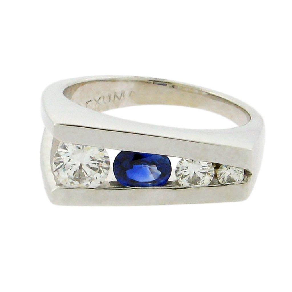 oval sapphire with three round diamonds set in 14 k white gold