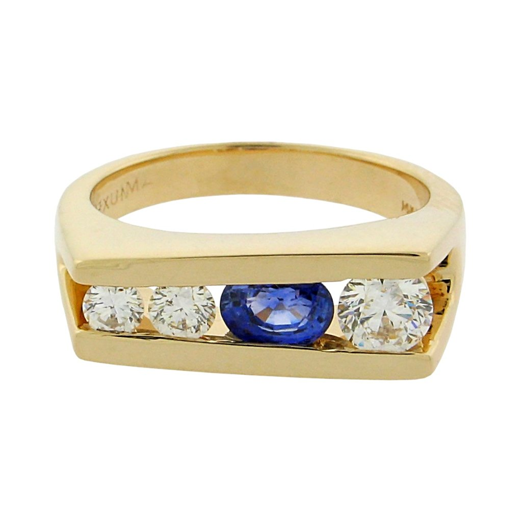 .69 ct oval sapphire  .46 ct total weight round diamonds  14 k yellow gold ring
