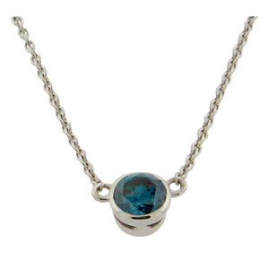 Blue diamond solitaire bezel set pendant in 14k white gold on a 14k chain