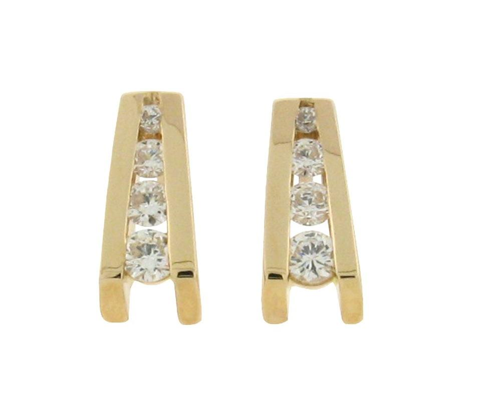 14 k yellow gold V shaped studs with 4 diamonds in each
