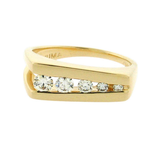 five round diamonds set in 14 k yellow gold