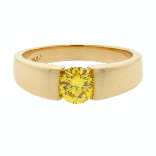 round fancy yellow diamond set in a 14 k yellow gold ring