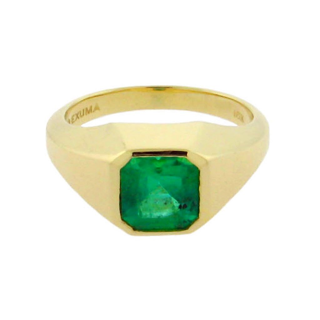 large square emerald set in a 14 k yellow gold ring