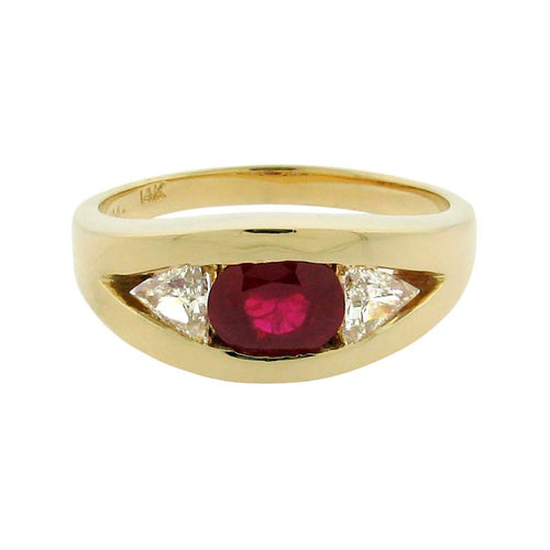 2.03 ct cushion-cut ruby  .78 ct total weight trillion cut diamonds  14 k yellow gold ring