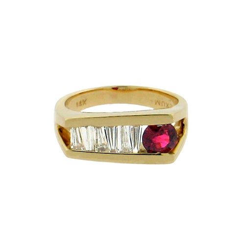 .60 ct round ruby  .72 total weight tapered baguette diamonds  14 k yellow gold ring