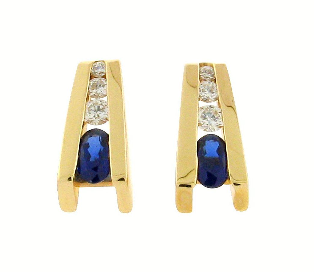 oval sapphires  .21 ct total weight diamonds  14 k yellow gold studs