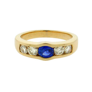 .95 ct oval sapphire  1.2 ct total weight round diamonds  14 k yellow gold ring