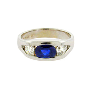 1.01 ct sapphire  .45 ct total weight round diamonds  14 k white gold ring
