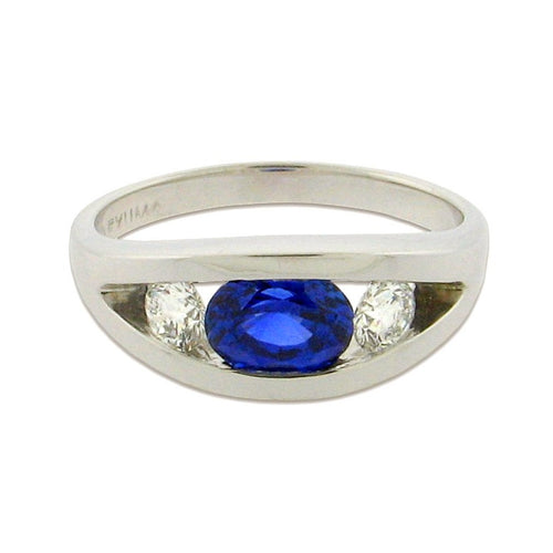 1.98 ct oval-cut brilliant sapphire  .64 ct total weight round diamonds  14 k white gold ring