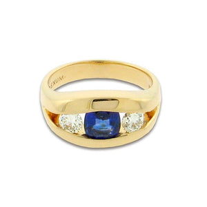 1.21 ct cushion cut sapphire  .60 ct total weight round diamonds  14 k yellow gold ring
