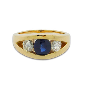 1.85 ct round blue sapphire  .92 ct total weight round diamonds  14 k yellow gold ring
