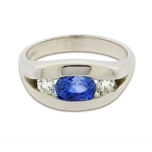 1.82 ct oval cut sapphire  .42 total weight round diamonds  14 k white gold ring