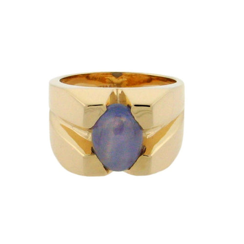 Double star cabochon sapphire set in 14 k yellow gold