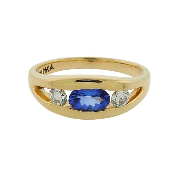 .51 ct oval tanzanite  .46 ct total weight round diamonds  14 k yellow gold ring