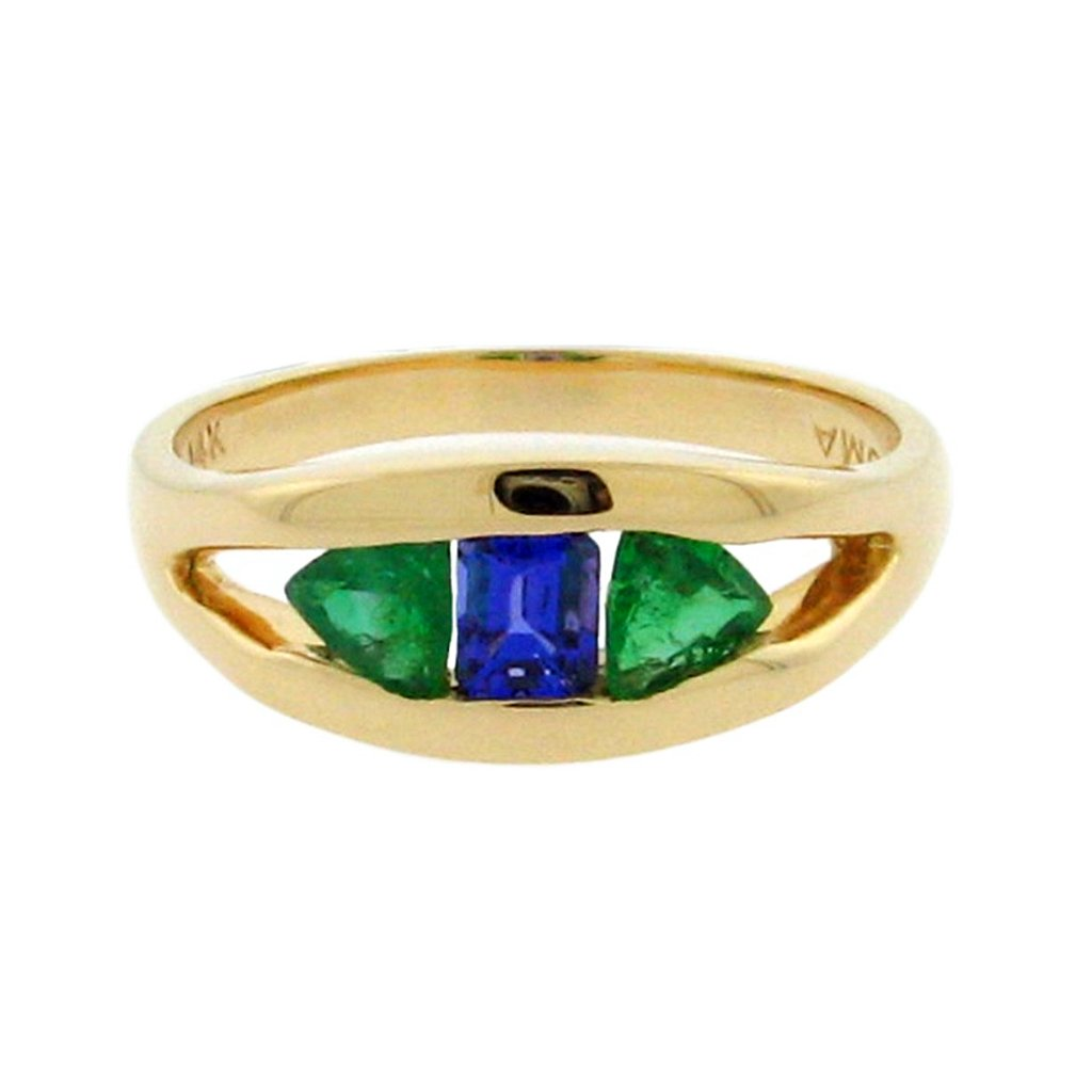 .27 ct emerald cut tanzanite  .37 ct total weight trillion cut emerald  14 k yellow gold ring