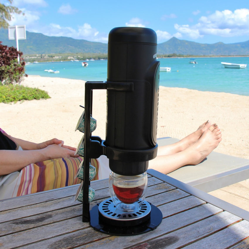 NowPresso Portable Espresso Machine Stand drinking Iced Coffee at Beach