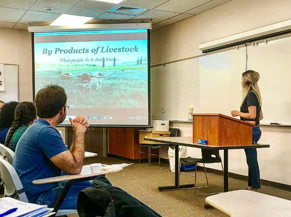 Cara Henri presenting to a classroom on beef by-products