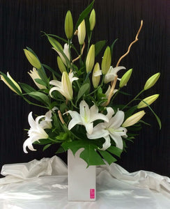 Oriental Lillies Presented in a Ceramic Vase