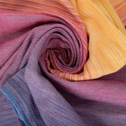 Girasol Nightfall Woven Wrap. Crema de Nube Weft. Shades of blue, Purple, pink, orange and yellow