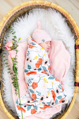 OVer Reversible Swaddle - Phyllis. Pink and floral.