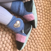Nooks Felted Wool Booties – Nebula The lavender-coloured wool body of the bootie has been paired with pink coloured wool uppers and chocolate brown leather toe and heel caps for a timeless feminine look that pairs well with any outfit.