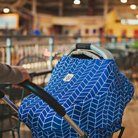 Harriston OVer Cover. Blue and white pattern. This OVer can be used as an infant carseat cover, nursing cover with 360° coverage, shopping cart cover and more