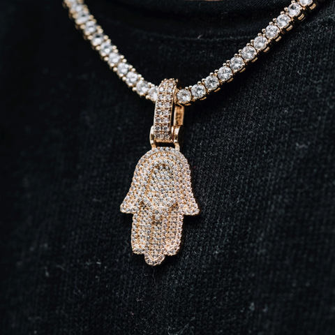 A gold hamsa necklace.
