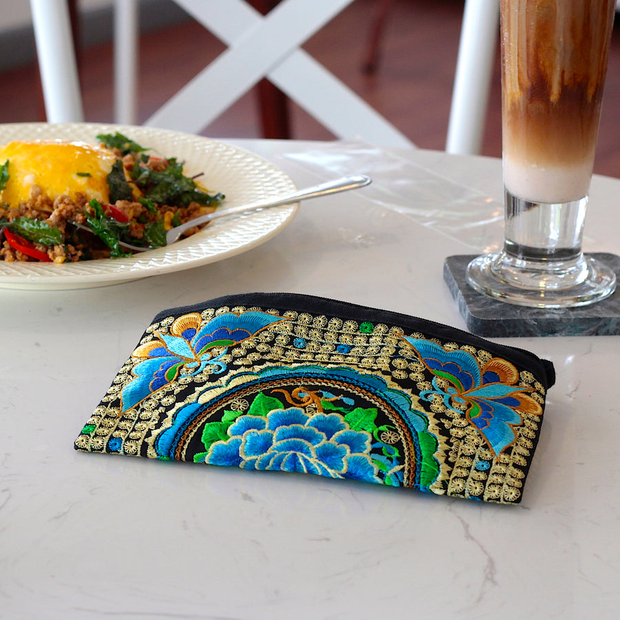 Sabai Jai Blue Atlas Moth Clutch on table