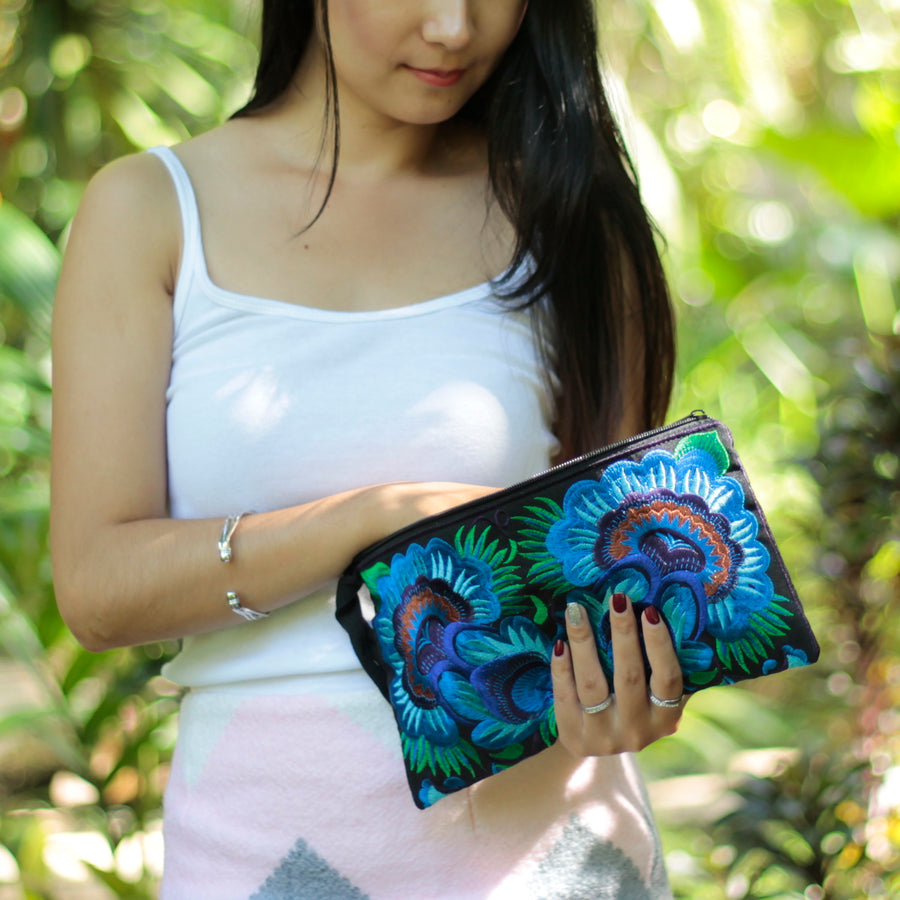 Sabai Jai Deep Blue Twin Flower Clutch with woman