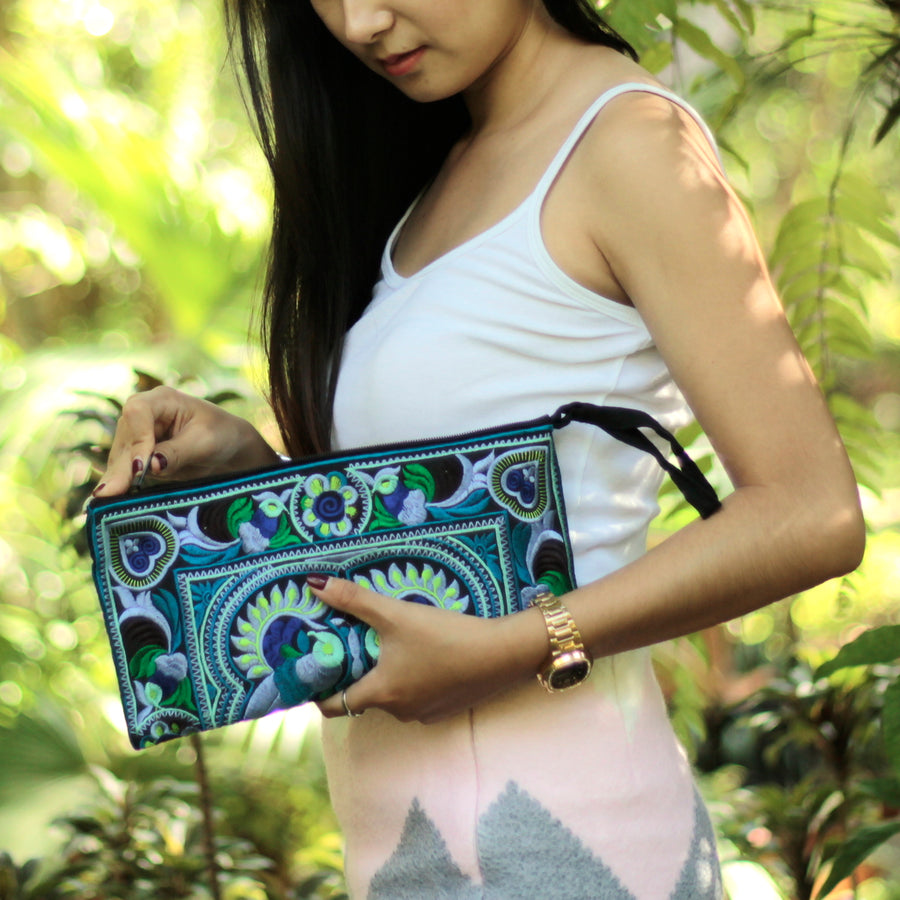 Sabai Jai Blue Medium Twin Bird Clutch held by woman