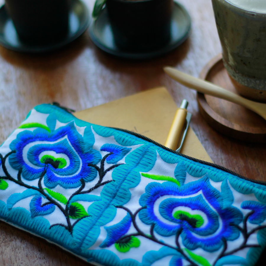 Sabai Jai Blue Small Floral Wristlet on table