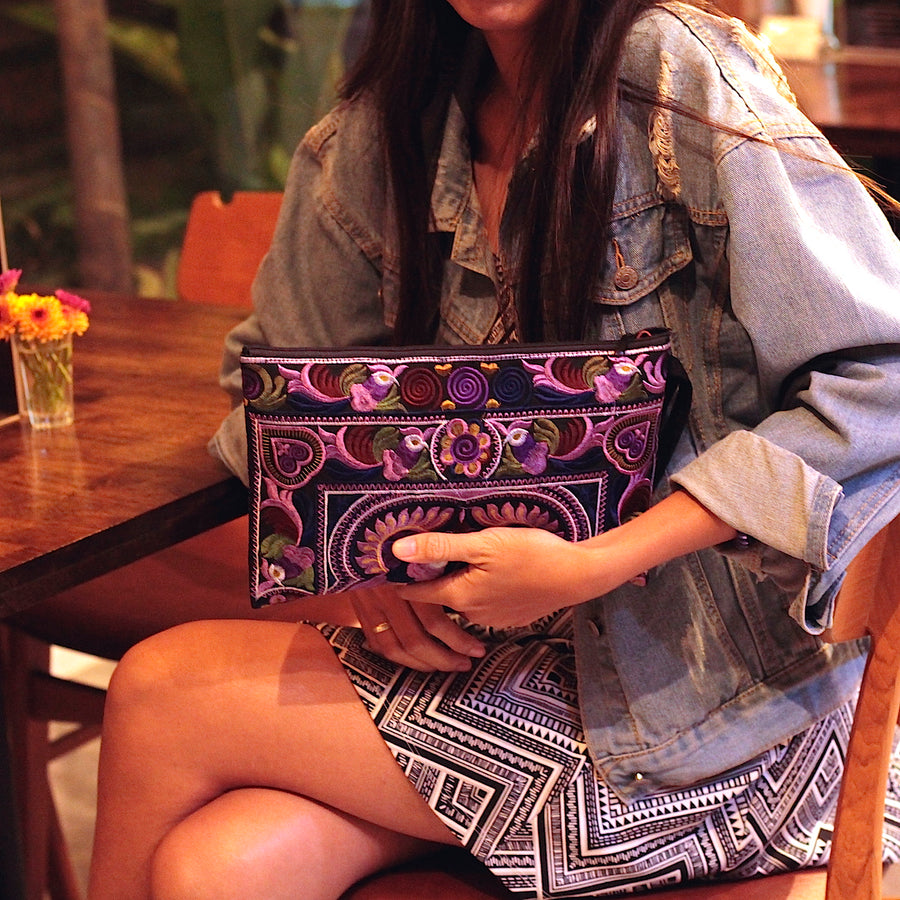 Sabai Jai Dark Violet Large Twin Bird Clutch held by woman