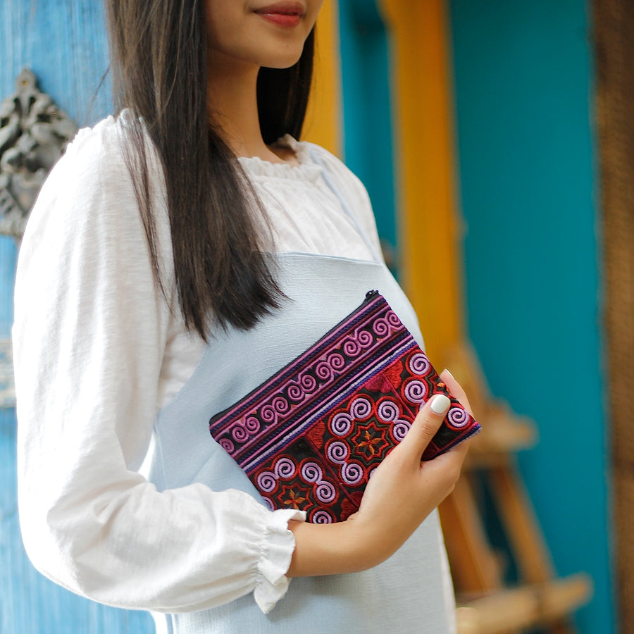 Sabai Jai Dark Violet Cosmetic Pouch held by woman