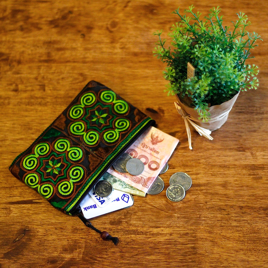 Sabai Jai Green Coin Purse on wood table