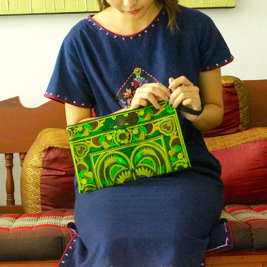 Sabai Jai Green Large Twin Bird Clutch with woman