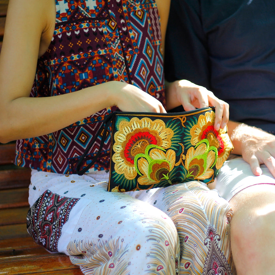 Sabai Jai Golden Green Twin Flower Clutch bag on lap