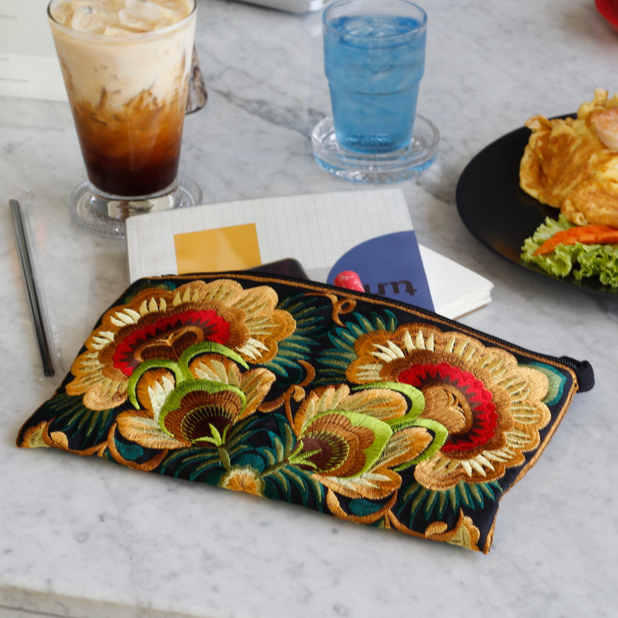 Sabai Jai Golden Green Twin Flower Clutch on table