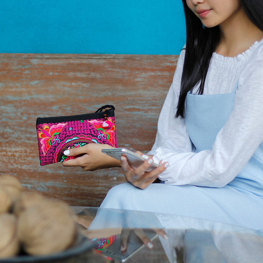 Sabai Jai Magenta Atlas Moth Clutch held by woman