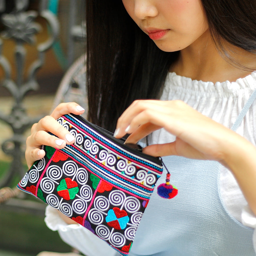 Sabai Jai Multicolor Cosmetic Pouch with woman
