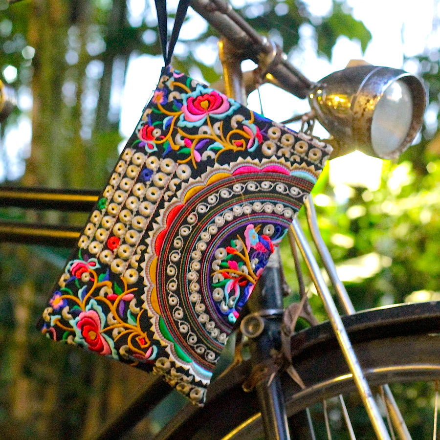 Sabai Jai Silver & Multicolor Rose Clutch front of bike
