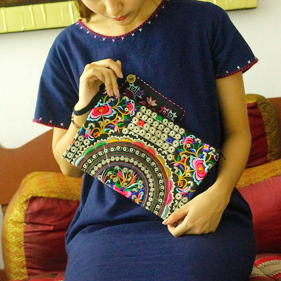 Sabai Jai Silver & Multicolor Rose Clutch held by woman