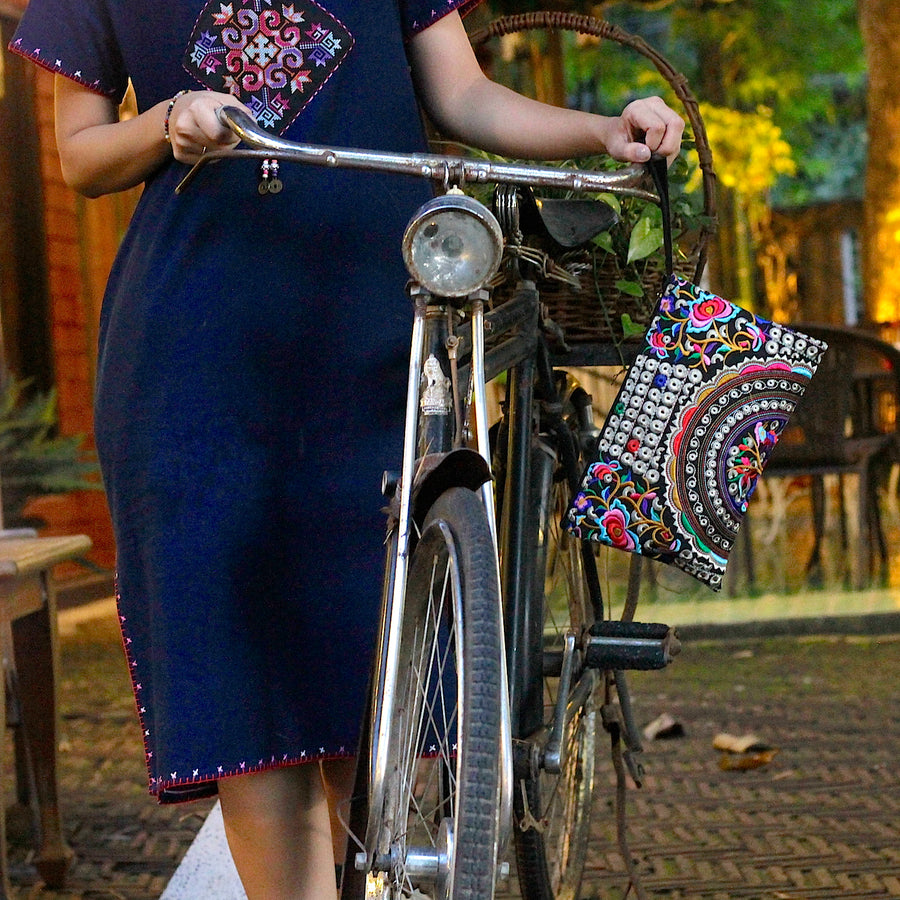 Sabai Jai Silver & Multicolor Rose Clutch on bike