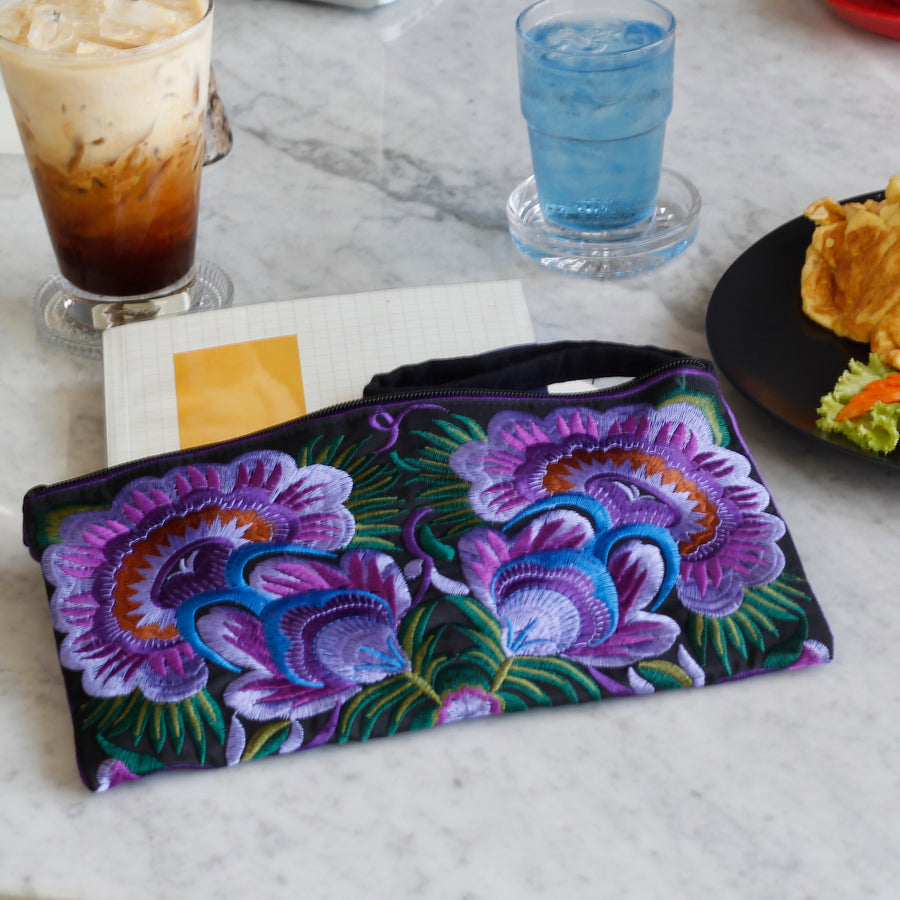 Sabai Jai Purple Twin Flower Clutch on table