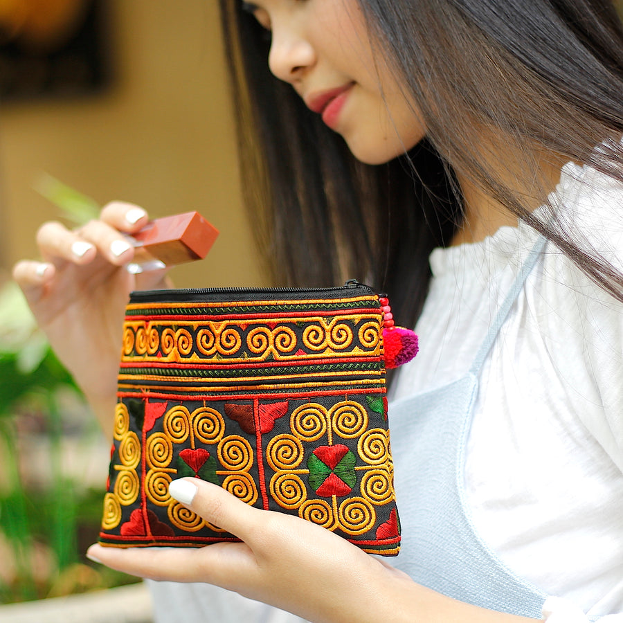 Sabai Jai Red Cosmetic Pouch on hand
