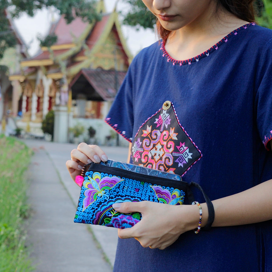 Sabai Jai Violet & Electric Blue Atlas Moth Clutch held